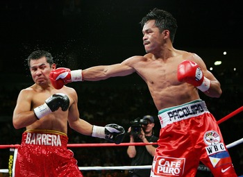 LAS VEGAS - OCTOBER 06:  Manny Pacquiao (R) hits Marco Antonio Barrera during the eighth round of their 12-round super featherweight bout at the Mandalay Bay Events Center October 6, 2007 in Las Vegas, Nevada. Pacquiao won by unanimous decision.  (Photo b