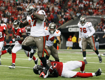 ATLANTA - NOVEMBER 07:  LeGarrette Blount #27 of the Tampa Bay Buccaneers breaks a tackle by Stephen Nicholas #54 of the Atlanta Falcons at Georgia Dome on November 7, 2010 in Atlanta, Georgia.  (Photo by Kevin C. Cox/Getty Images)