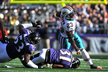 BALTIMORE, MD - NOVEMBER 7:  Ronnie Brown #23 of the Miami Dolphins runs the ball against the Baltimore Ravens at M&T Bank Stadium on November 7, 2010 in Baltimore, Maryland. The Ravens defeated the Dolphins 26-10. (Photo by Larry French/Getty Images)