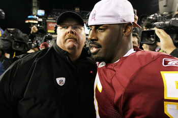 PHILADELPHIA - OCTOBER 03:  Donovan McNabb #5 of the Washington Redskins meets with head coach Andy Reid of the Philadelphia Eagles after their game on October 3, 2010 at Lincoln Financial Field in Philadelphia, Pennsylvania. The Redskins defeated the Eag