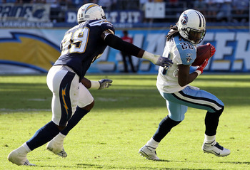 SAN DIEGO - OCTOBER 31:  Chris Johnson #28 of the Tennessee Titans is pursued by Seyi Ajirotutu #89 of the San Diego Chargers in the game at Qualcomm Stadium on October 31, 2010 in San Diego, California. The Chargers defeated the Titans 33-25.  (Photo by