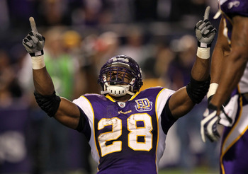MINNEAPOLIS - NOVEMBER 07:  Running back Adrian Peterson #28 of the Minnesota Vikings celebrates after his four yard touchdown run brought the Vikings within a touchdown of the Arizona Cardinals in the fourth quarter at Hubert H. Humphrey Metrodome on Nov