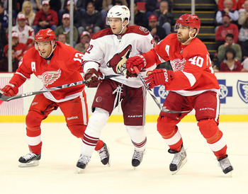 DETROIT, MI - NOVEMBER 8:  Pavel Datsyuk #13 and Henrik Zetterberg #40 of the Detroit Red Wings sandwich Lee Stempniak #22 of the Phoenix Coyotes in a game on November 8,2010 at the Joe Louis Arena in Detroit, Michigan. (Photo by Claus Andersen/Getty Imag
