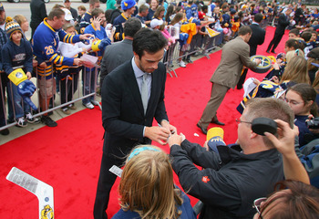 BUFFALO, NY - SEPTEMBER 25:  Ryan Miller of the Buffalo Sabres sighns autographs for fans during a red carpet arrival for the players prior to playing the Toronto Maple Leafs at HSBC Arena on September 25, 2010 in Buffalo, New York.  (Photo by Rick Stewar