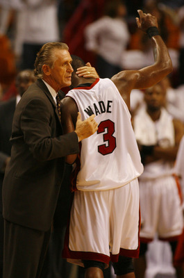 MIAMI - APRIL 29:  Guard Dwyane Wade #3 of the Miami Heat gets a hug from Head Coach Pat Riley in the fourth period against the Chicago Bulls in Game Four of the Eastern Conference Quarterfinals during the 2007 NBA Playoffs on April 29, 2007 at American A