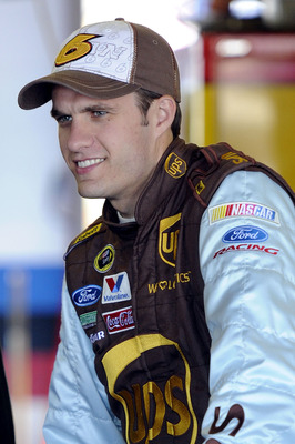 TALLADEGA, AL - OCTOBER 29:  David Ragan, driver of the #6 UPS Ford, stands in the garage during practice for the NASCAR Sprint Cup Series AMP Energy Juice 500 at Talladega Superspeedway on October 29, 2010 in Talladega, Alabama.  (Photo by John Harrelson