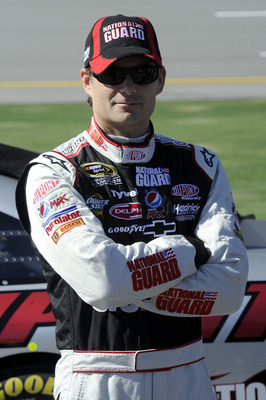 TALLADEGA, AL - OCTOBER 30:  Jeff Gordon, driver of the #24 DuPont/National Guard Chevrolet, stands next to his car on pit road during qualifying for the NASCAR Sprint Cup Series AMP Energy Juice 500 at Talladega Superspeedway on October 30, 2010 in Talla