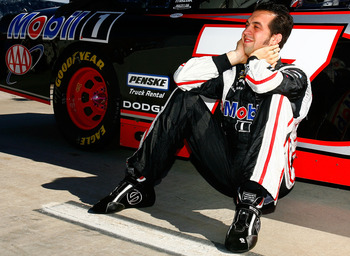 MARTINSVILLE, VA - OCTOBER 24:  Sam Hornish Jr., driver of the #77 Mobil 1 Dodge, sits next to his car on the grid prior to the NASCAR Sprint Cup Series TUMS Fast Relief 500 at Martinsville Speedway on October 24, 2010 in Martinsville, Virginia.  (Photo b