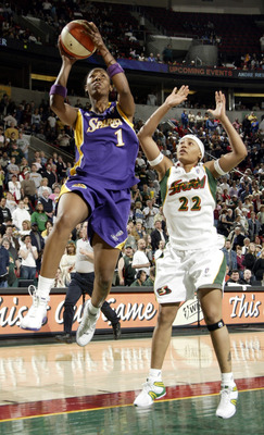 SEATTLE - MAY 21:  Chamique Holdsclaw #1 of the Los Angeles Sparks shoots against Betty Lennox #22 of the Seattle Storm at Key Arena on May 21, 2005 in Seattle, Washington. NOTE TO USER: User expressly acknowledges and agrees that, by downloading and/or u