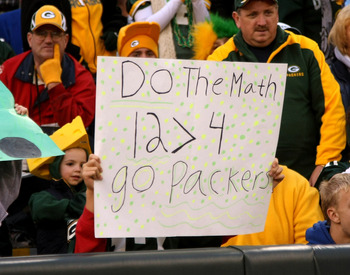 GREEN BAY, WI - OCTOBER 19:  A Packer fan holds a sign supporting Aaron Rodgers over Brett Favre during the game between the Green Bay Packers and the Indianapolis Colts on October 19, 2008 at Lambeau Field in Green Bay Wisconsin. The Packers won 34-14.
