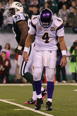 EAST RUTHERFORD, NJ - OCTOBER 11:  Quarterback Brett Favre #4 of the Minnesota Vikings reacts as he walks back to the sideline in the fourth quarter against the New York Jets at New Meadowlands Stadium on October 11, 2010 in East Rutherford, New Jersey.