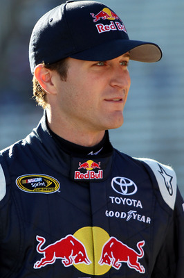 FORT WORTH, TX - NOVEMBER 05:  Kasey Kahne, driver of the #83 Red Bull Toyota, walks on the grid during qualifying for the NASCAR Sprint Cup Series AAA Texas 500 at Texas Motor Speedway on November 5, 2010 in Fort Worth, Texas.  (Photo by Jonathan Ferrey/