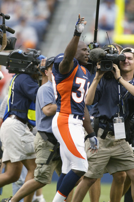 DENVER - AUGUST 19:  Running back Terrell Davis #30 of the Denver Broncos waves and salutes to the crowd before a preseason game against the San Francisco 49ers August 19, 2002, at Mile High Stadium in Denver, Colorado.   Davis did not play and is expecte