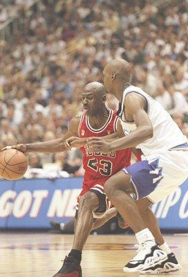 11 Jun 1997:  Guard Michael Jordan of the Chicago Bulls tries to drive past forward Bryon Russell of the Utah Jazz during a playoff game at the Delta Center in Salt Lake City, Utah.  The Bulls won the game 90-88. Mandatory Credit: Brian Bahr  /Allsport
