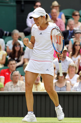 LONDON, ENGLAND - JUNE 25:  Justine Henin of Belgium celebrates winning her match against Nadia Petrova of Russia on Day Five of the Wimbledon Lawn Tennis Championships at the All England Lawn Tennis and Croquet Club on June 25, 2010 in London, England.