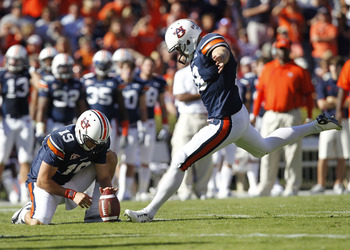 AUBURN - OCTOBER 16:  Field goal kicker Wes Byrum #18 of the Auburn Tigers prepares to kick a field goal in the second quarter while Neil Caudle #19 holds the ball during the game against the Arkansas Razorbacks at Jordan-Hare Stadium on October 16, 2010