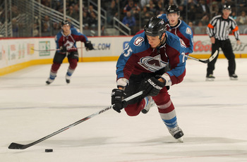 DENVER - NOVEMBER 09:  Chris Stewart #25 of the Colorado Avalanche controls the puck against the Calgary Flames at the Pepsi Center on November 9, 2010 in Denver, Colorado. The Flames defeated the Avalanche 4-2.  (Photo by Doug Pensinger/Getty Images)