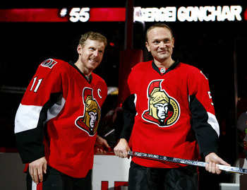 OTTAWA, ON - OCTOBER 26:  In honour of his 1000th NHL regular season game Daniel Alfredsson #11 of the Ottawa Senators presents the traditional silver stick to Sergei Gonchar #55  before a game against the Phoenix Coyotes at Scotiabank Place on October 26
