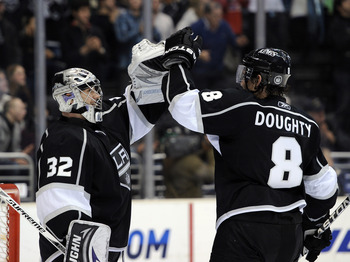 LOS ANGELES, CA - NOVEMBER 11:  Jonathan Quick #32 and Drew Doughty #8 of the Los Angeles Kings celebrates a 3-1 win over the Dallas Stars at the Staples Center on November 11, 2010 in Los Angeles, California.  (Photo by Harry How/Getty Images)