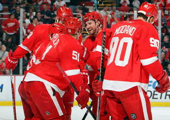 DETROIT - NOVEMBER 11:  Niklas Kronwall #55 (center) of the Detroit Red Wings celebrates a 3rd period goal by his team against the Edmonton Oilers during their NHL game at Joe Louis Arena on November 11, 2010 in Detroit, Michigan.(Photo By Dave Sandford/G