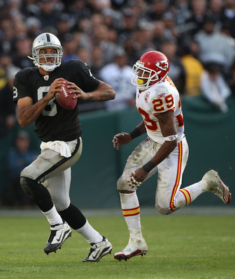 OAKLAND, CA - NOVEMBER 07:  Jason Campbell #8 of the Oakland Raiders runs against Eric Barry #29 of the Kansas City Chiefs during an NFL game at Oakland-Alameda County Coliseum on November 7, 2010 in Oakland, California.  (Photo by Jed Jacobsohn/Getty Ima