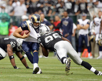 OAKLAND, CA - SEPTEMBER 19:  Sam Bradford #8 of the St. Louis Rams is sacked by Kamerion Wimbley #96 of the Oakland Raiders at the Oakland-Alameda County Coliseum on September 19, 2010 in Oakland, California.  (Photo by Ezra Shaw/Getty Images)