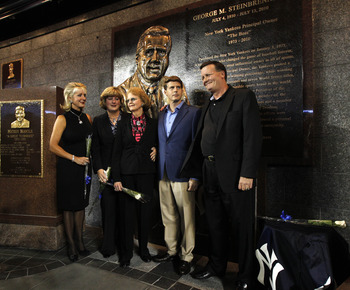 NEW YORK - SEPTEMBER 20:  Members of the Steinbrenner family pose for photographers following a ceremony dedicating a monument to the late Yankees principal owner George Steinbrenner before the Yankees baseball game against the Tampa Bay Rays on September