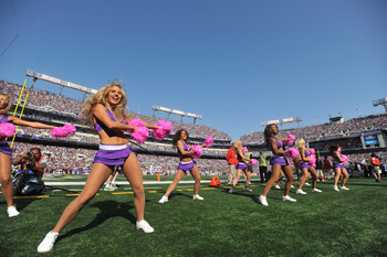 BALTIMORE, MD - OCTOBER 10: Cheerleaders for the Baltimore Ravens cheer during the game against the Denver Broncos at M&T Bank Stadium on October 10, 2010 in Baltimore, Maryland. Players wore pink in recognition of Breast Cancer Awareness Month. The Raven