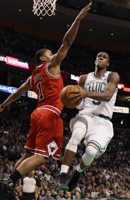 BOSTON, MA - NOVEMBER 05:  Rajon Rondo #9 of the Boston Celtics takes a shot as Derrick Rose #1 of the Chicago Bulls defends on November 5, 2010 at the TD Garden in Boston, Massachusetts.  NOTE TO USER: User expressly acknowledges and agrees that, by down