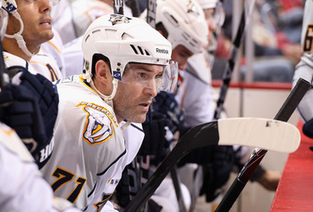 GLENDALE, AZ - NOVEMBER 03:  J.P. Dumont #71 of the Nashville Predators watches from the bench during the NHL game against the Phoenix Coyotes at Jobing.com Arena on November 3, 2010 in Glendale, Arizona.  The Coyotes defeated the Predators 4-3.  (Photo b