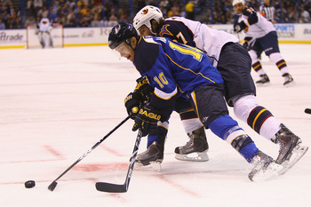 ST. LOUIS - OCTOBER 30: Andy McDonald #10 of the St. Louis Blues looks to control the puck against the Atlanta Thrashers at the Scottrade Center on October 30, 2010 in St. Louis, Missouri.  (Photo by Dilip Vishwanat/Getty Images)
