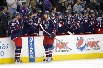 COLUMBUS, OH - NOVEMBER 6:  Rick Nash #61 of the Columbus Blue Jackets is congratulated by his teammates after scoring a goal against the Minnesota Wild during the first period on November 6, 2010 at Nationwide Arena in Columbus, Ohio.  (Photo by John Gri