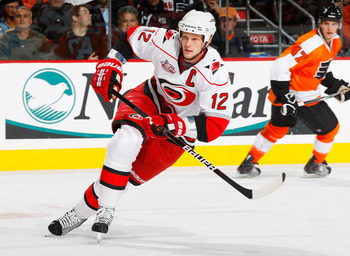PHILADELPHIA - NOVEMBER 01:  Eric Staal #12 of the Carolina Hurricanes skates against the Philadelphia Flyers on November 1, 2010 at the Wells Fargo Center in Philadelphia, Pennsylvania. Flyers defeat the Hurricanes 3-2.  (Photo by Mike Stobe/Getty Images