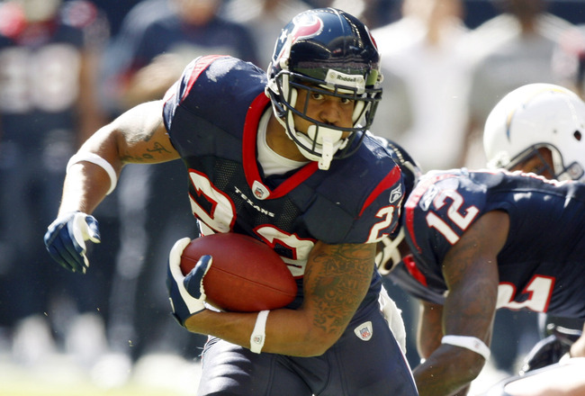 HOUSTON - NOVEMBER 07:  Running back Arian Foster #23 of the Houston Texans rushes in the first half against the San Diego Chargers at Reliant Stadium on November 7, 2010 in Houston, Texas.  (Photo by Bob Levey/Getty Images)