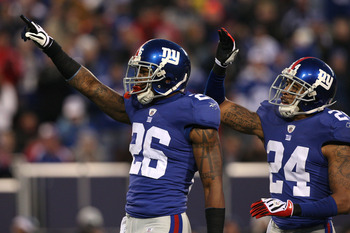 EAST RUTHERFORD, NJ - DECEMBER 06:  (L-R) Aaron Rouse #26 and Terrell Thomas #24 of the New York Giants celebrate a defensive play against the Dallas Cowboys at Giants Stadium on December 6, 2009 in East Rutherford, New Jersey.  (Photo by Jim McIsaac/Gett