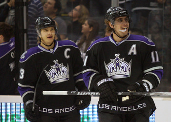 LOS ANGELES, CA - NOVEMBER 06:  Dustin Brown #23 and Anze Kopitar #11 of the Los Angeles Kings look on after celebrating Kopitar's first-period goal against the Nashville Predators during the NHL game at Staples Center on November 6, 2010 in Los Angeles,