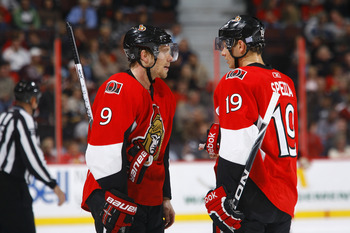 OTTAWA, ON - OCTOBER 14:  Milan Michalek #9 and Jason Spezza #19 of the Ottawa Senators discuss strategy during a game against the Carolina Hurricanes at Scotiabank Place on October 14, 2010 in Ottawa, Ontario, Canada.  The Ottawa Senators defeated the Ca