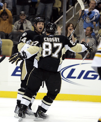 PITTSBURGH - NOVEMBER 10:  Brooks Orpik #44 of the Pittsburgh Penguins celebrates his goal first period goal with Sidney Crosby #87 against the Boston Bruins at Consol Energy Center on November 10, 2010 in Pittsburgh, Pennsylvania.  (Photo by Justin K. Al