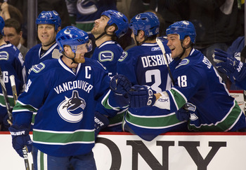 VANCOUVER, CANADA - NOVEMBER 01: Henrik Sedin #33 of the Vancouver Canucks is congratulated by teammate Peter Schaefer #18 after scoring on a penalty shot against the New Jersey Devils during the third period in NHL action on November 01, 2010 at Rogers A