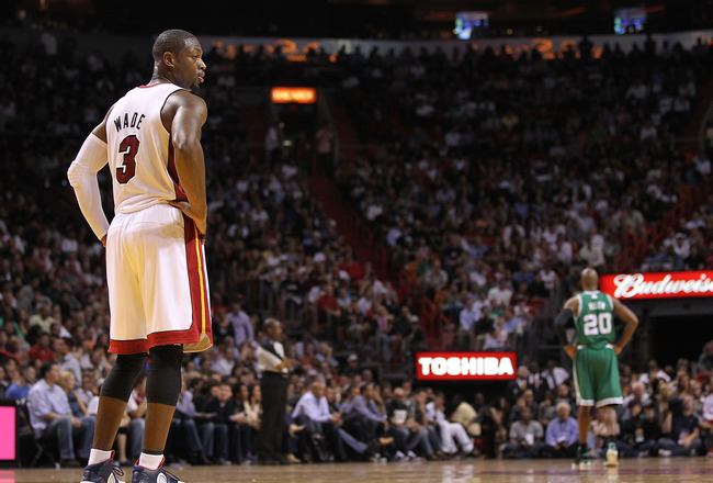 MIAMI - NOVEMBER 11:  Dwyane Wade #3 of the Miami Heat waits during a foul shot during a game against the Boston Celtics at American Airlines Arena on November 11, 2010 in Miami, Florida. NOTE TO USER: User expressly acknowledges and agrees that, by downl
