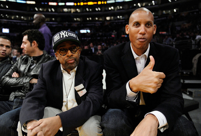 LOS ANGELES, CA - NOVEMBER 24: Former NBA star Reggie Miller of the Indiana Pacers and film maker Spike Lee look on during the NBA game between the New York Knicks and Los Angeles Lakers Staples Center on November 24, 2009 in Los Angeles, California.  NOT