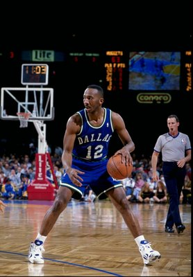 Guard Derek Harper of the Dallas Mavericks in action during a game against the Denver Nuggets at the McNichols Sports Arena in Denver, Colorado.