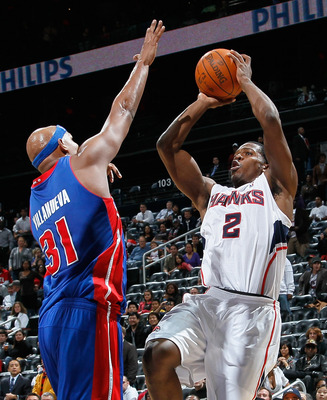 ATLANTA - NOVEMBER 03:  Joe Johnson #2 of the Atlanta Hawks shoots against Charlie Villanueva #31 of the Detroit Pistons at Philips Arena on November 3, 2010 in Atlanta, Georgia.  NOTE TO USER: User expressly acknowledges and agrees that, by downloading a