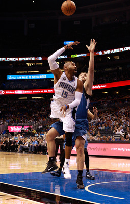 ORLANDO, FL - NOVEMBER 03:  Vince Carter #15 of the Orlando Magic drives against Nikola Pekovic #14 of the Minnesota Timberwolves during the game at Amway Arena on November 3, 2010 in Orlando, Florida.  NOTE TO USER: User expressly acknowledges and agrees