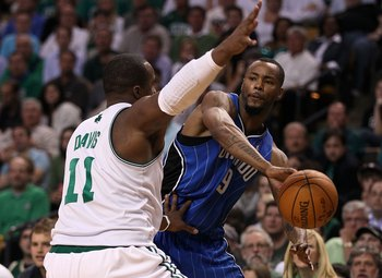 BOSTON - MAY 28:  Rashard Lewis #9 of the Orlando Magic looks to pass the ball against Glen Davis #11 of the Boston Celtics in Game Six of the Eastern Conference Finals during the 2010 NBA Playoffs at TD Garden on May 28, 2010 in Boston, Massachusetts.  N