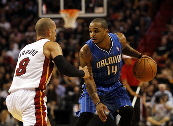 MIAMI - OCTOBER 29:  Guard Jameer Nelson #14 of the Orlando Magic brings up the ball against guard Carlos Arroyo #8 of the Miami Heat at American Airlines Arena on October 29, 2010 in Miami, Florida.  NOTE TO USER: User expressly acknowledges and agrees t