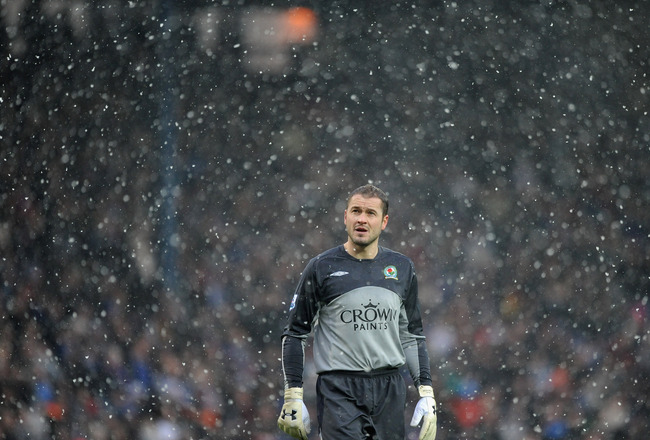 BLACKBURN, ENGLAND - DECEMBER 19: Paul Robinson of Blackburn Rovers looks on in the snow during the Barclays Premier League Match between Blackburn Rovers and Tottenham Hotspur at Ewood Park on December 19, 2009 in Blackburn, England.  (Photo by Laurence