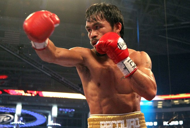 ARLINGTON, TX - MARCH 13:  Manny Pacquiao of the Philippines throws a punch in the ring against Joshua Clottey of Ghana during the WBO welterweight title fight at Cowboys Stadium on March 13, 2010 in Arlington, Texas. Pacquiao defeated Clottey by unanimou