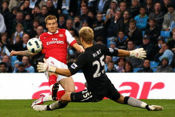 MANCHESTER, ENGLAND - OCTOBER 24:  Nicklas Bendtner of Arsenal scores the third goal past Joe Hart of City during the Barclays Premier League match between Manchester City and Arsenal at City of Manchester Stadium on October 24, 2010 in Manchester, Englan