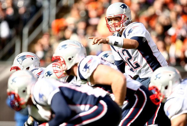 CLEVELAND - NOVEMBER 07:  Quarterback Tom Brady #12 of the New England Patriots calls a play against the Cleveland Browns at Cleveland Browns Stadium on November 7, 2010 in Cleveland, Ohio.  (Photo by Matt Sullivan/Getty Images)